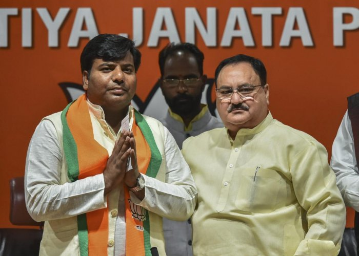 BJP leader and Union minister J P Nadda greets Nishad Party leader and Gorakhpur MP Praveen Nishad after he joined the BJP, in New Delhi on April 04. PTI