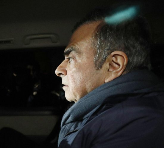 In this April 3, 2019 photo, former Nissan Chairman Carlos Ghosn in a car leaves his lawyer's office in Tokyo. Japanese prosecutors took Ghosn for questioning Thursday, April 4, 2019, barely a month after he was released on bail ahead of his trial on fina