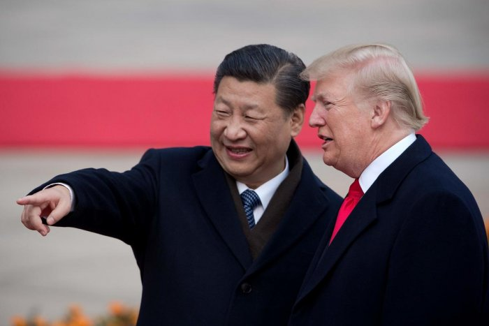 In this file photo taken on November 8, 2017, China's President Xi Jinping (L) and US President Donald Trump attend a welcome ceremony at the Great Hall of the People in Beijing. - The White House on April 4, 2019, stoked anticipation Trump could announce