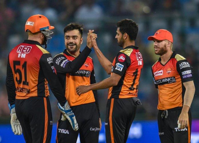 SCALPING THE BIG FISH: Sunrisers Hyderabad's Rashid Khan (centre) celebrates with team-mates after dismissing Delhi Capitals captain Shreyas Iyer in New Delhi on Thursday. PTI