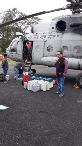 Polling personnel after being airlifted at Vijaynagar, Arunachal Pradesh on Thursday. Photo credit: CEO, Arunachal Pradesh.