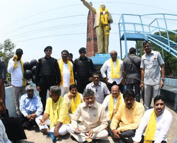 AP Chief Minister Nara Chandrababu Naidu protesting at the B R Ambedkar statue in Vijayawada on Friday.