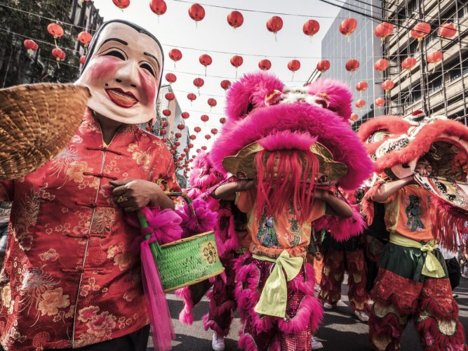 Bangkok, Thailand - February 8, 2016: Lion dance and people with chinese masks at Yaowarat Road during the celebration of the Chinese New Year in Chinatown Bangkok Thailand