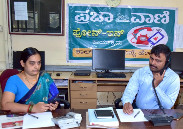Sveep Committee Chairman and Zilla Panchayat Chief Executive Officer R Selvamani attends a phone call during phone-in programme organised by Prajavani at DH-PV Editorial Office in Balmatta on Friday. Assistant Returning Officer Gayathri Nayak looks on.