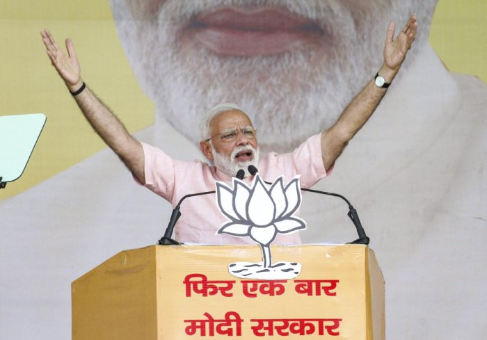 Saharanpur: Prime Minister Narendra Modi gestures as he speaks during an election rally, ahead of the Lok Sabha polls, in Saharanpur, Friday, April 05, 2019. (PTI Photo) (PTI4_5_2019_000180B)