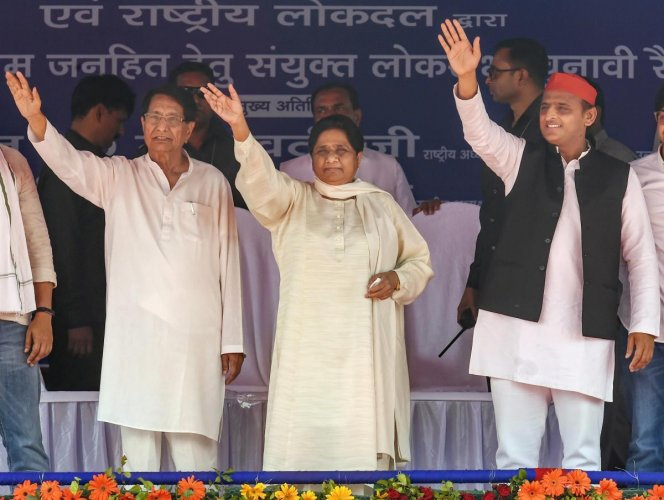 Samajwadi Party President Akhilesh Yadav, Bahujan Samaj Party supremo Mayawati, RLD chief Ch Ajit Singh wave at the supporters during their joint election campaign rally at Deoband in Saharanpur, Sunday, April 7, 2019. (PTI Photo)