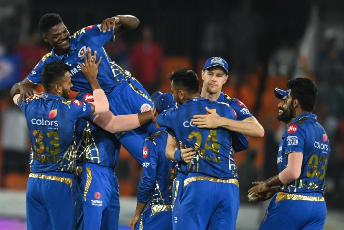 HEROIC: Mumbai Indians' Alzarri Joseph (centre) is lifted by his team-mates during their game against Sunrisers Hyderabad. AFP