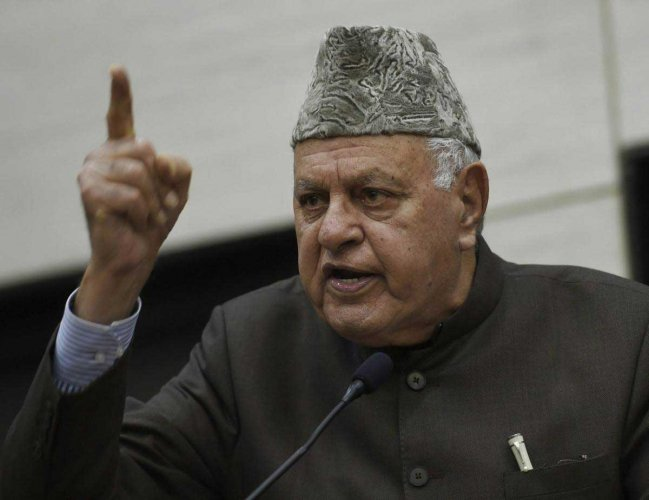 """Reacting sharply to the BJP's promise to revoke Article 370, NC president and former union minister Farooq Abdullah said, """"Do they (New Delhi) think that they will abrogate Article 370 and we will be quiet? They are wrong. We will fight against it."""" (PTI File Photo)"""
