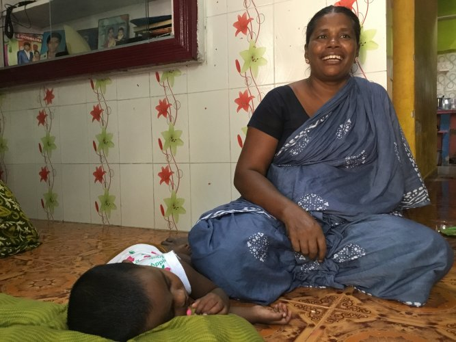 Vanitha, Snowlin's mother, putting her grand daughter Jibansi to sleep at her house in Thoothukudi. (DH photo by ETB Sivapriyan)