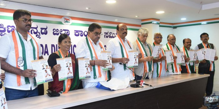 MLC and DCC president Harish Kumar releases the Congress manifesto for Dakshina Kannada at the party office in Mangaluru on Sunday.