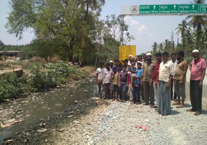 Residents stage a protest on Ajjampura Road, highlighting the pathetic condition of the stormwater drain.