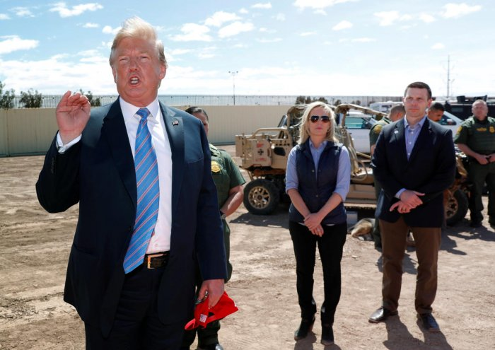 Homeland Security Secretary Kirstjen Nielsen and commissioner for Customs and Border Patrol Kevin McAleenan listen to U.S. President Donald Trump speak during a visit to a section of border wall in Calexico California, U.S. Reuters photo