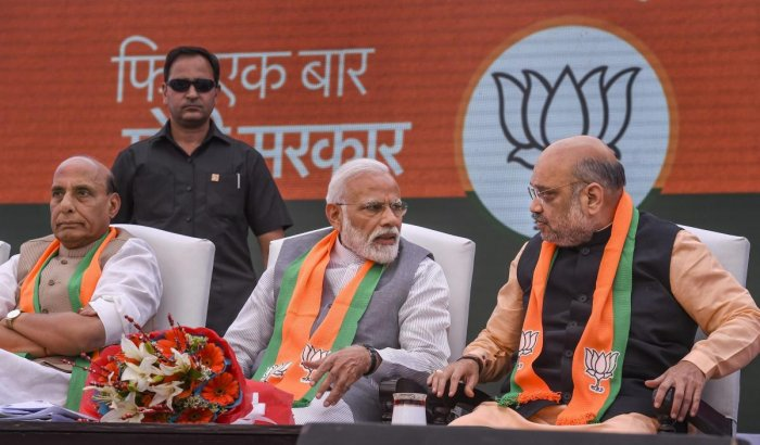 Prime Minister Narendra Modi, BJP President Amit Shah and Union Home Minister Rajnath Singh during the release of Bharatiya Janata Party's (BJP) manifesto for Lok Sabha elections 2019, in New Delhi. (PTI Photo)