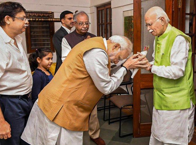 Prime Minister Narendra Modi greets BJP senior leader L K Advani on his birthday at his residence, in New Delhi, on November 8, 2018. Twitter Photo via PTI