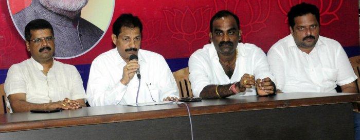 BJP Udupi district president Mattar Rathnakar Hegde speaks to reporters in Udupi on Monday.