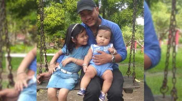 The detained journalist Kishorechandra Wangkhem with his two daughters. DH photo
