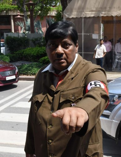 Film actor turned politician Naramalli Sivaprasad, arrives at parliament dressed as Adolf Hitler to press for government funding for his home state of Andhra Pradesh, in New Delhi on August 9, 2018.