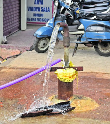 Borewell water pumping out at Old Airport Road, Domlur in Bengaluru. DH photo/S K Dinesh