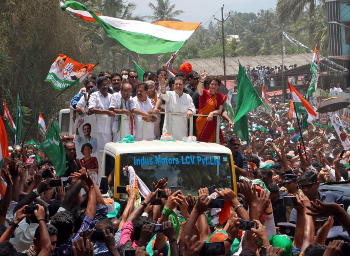 Congress chief Rahul Gandhi and his sister Priyanka Gandhi Vadra wave to their supporters after Rahul filed his nomination papers for the general election, in Wayanad in Kerala on April 4, 2019. REUTERS