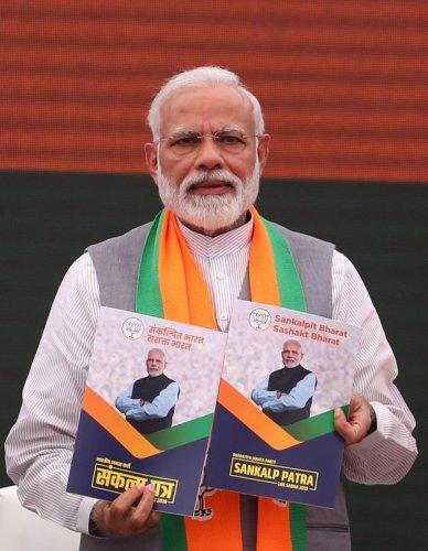 Prime Minister Narendra Modi presents the BJP election manifesto in New Delhi on April 8, 2019. STR/AFP