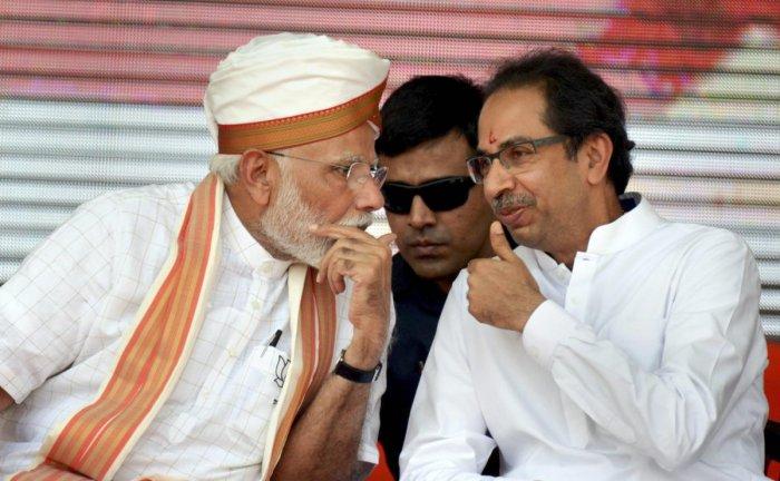 Prime Minister Narendra Modi with Shiv Sena chief Uddhav Thackeray. PTI file photo
