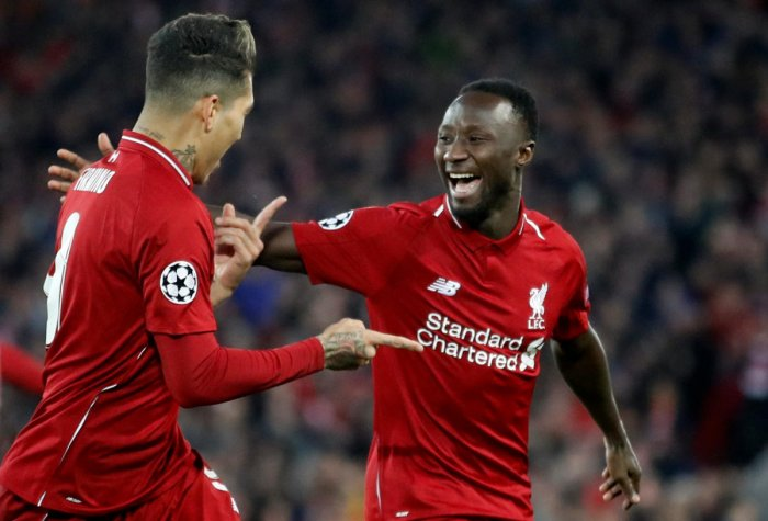 DYNAMIC DUO: Liverpool's Naby Keita (right) celebrates with Roberto Firmino after scoring against Porto on Tuesday. Reuters