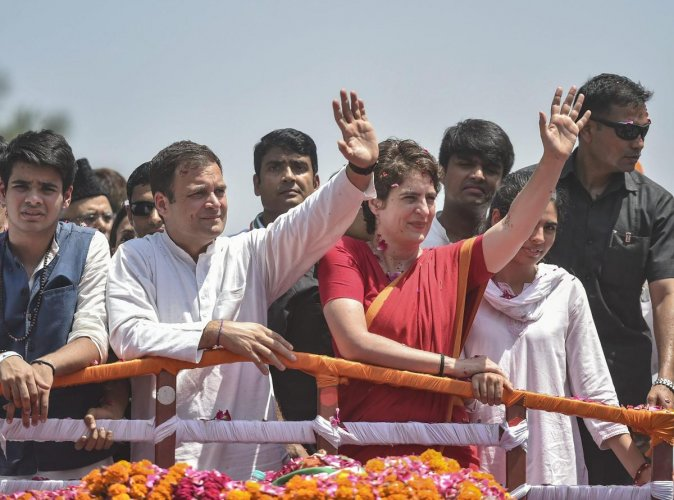 Congress President Rahul Gandhi flanked by party General Secretary Priyanka Gandhi Vadra and her children, embark on a roadshow, before filing the nomination papers for Amethi Lok Sabha seat in Amethi on Wednesday. PTI photo