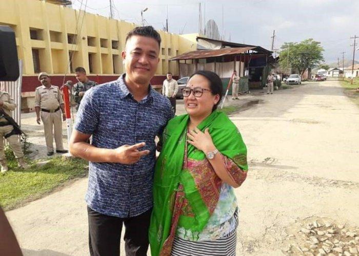 Kishorechandra Wangkhem with his wife outside Sajiwa jail in Imphal on Wednesday. Photo by V. Thockchom.