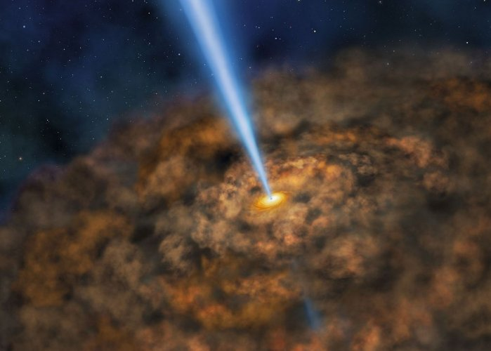 This NASA artist illustration obtained June 14, 2017, shows the thick ring of dust that can obscure the energetic processes that occur near the supermassive black hole of active galactic nuclei.