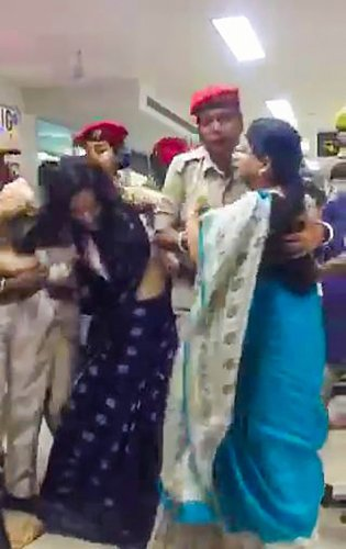 Trinamool Congress delegation being stopped by Assam Police as they arrived to assess the situation in Assam in the wake of the publication of the complete draft of the NRC, at Kumbhirgram airport in Silchar on Thursday. PTI