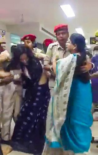 *BEST QUALITY AVAILABLE** Silchar: Trinamool Congress delegation being stopped by Assam Police as they arrived to assess the situation in Assam in the wake of the publication of the complete draft of the NRC, at Kumbhirgram airport in Silchar on Thursday,