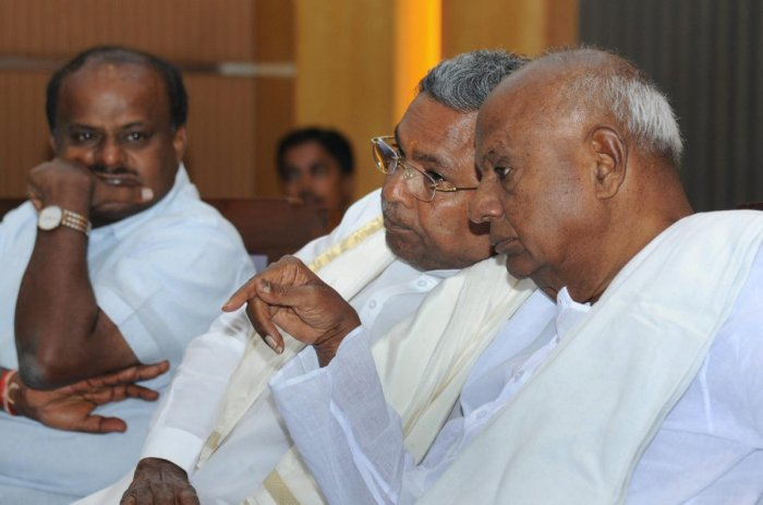 Former prime minister and JDS National President HD Devegowda(R), former chief minister Siddaramaiah(c) and Karnataka Chief Minister HD Kumaraswamy. PTI file photo