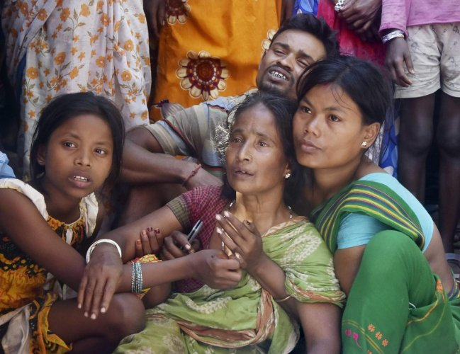 Relatives mourn the death of a family member killed by suspected United Liberation Front of Assam (ULFA) in Tinsukia district of Assam. (PTI File Photo)
