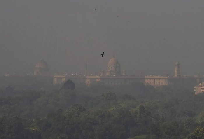 A view of the Rashtrapati Bhawan and South Block building enveloped in a blanket of smog in New Delhi. PTI File Photo