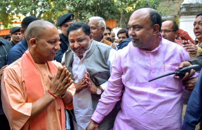 Uttar Pradesh Chief Minister Yogi Adityanath is greeted as he arrives at Bharatiya Janata Party (BJP) office, in Lucknow, Monday, March 11, 2019. (PTI Photo)