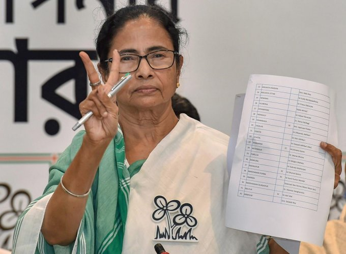 West Bengal Chief Minister and TMC chief Mamata Banerjee shows the candidates' list for Lok Sabha elections 2019 in Kolkata on Tuesday. PTI