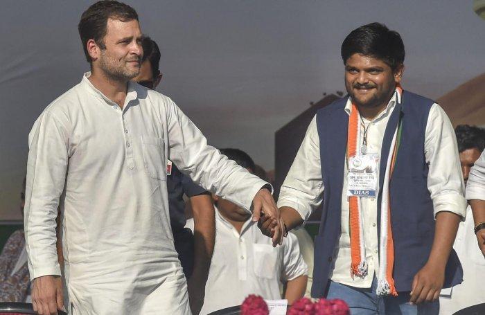 Patidar leader Hardik Patel with Congress president Rahul Gandhi as he joins the Congress, during a public meeting in Gandhinagar on March 12, 2019. (PTI Photo)