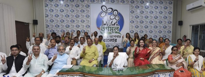 West Bengal Chief Minister and TMC Supremo Mamata Banerjee poses with her party candidates, contesting for the upcoming Lok Sabha polls, during a meeting, in Kolkata, Wednesday, March 13, 2019. (PTI Photo)