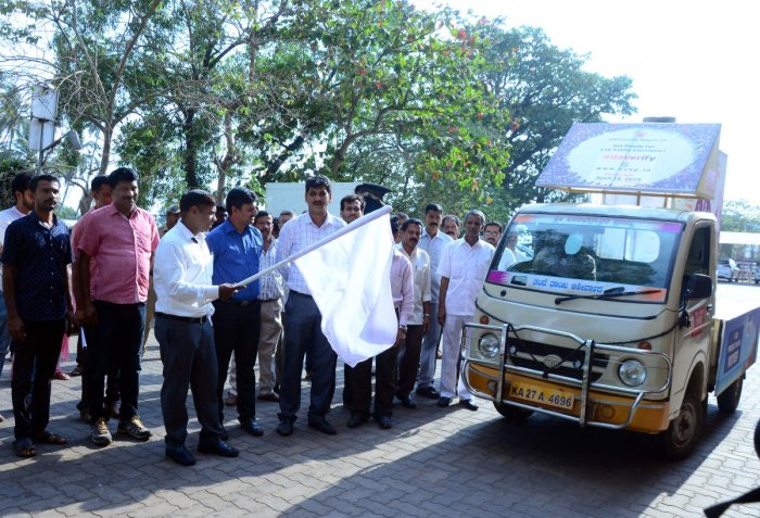Deputy Commissioner and District Returning Officer Sasikanth Senthil flags off 'Matadana Jagruti Ratha', on the premises of DC's office in Mangaluru on Saturday. District SVEEP committee chairman and zilla panchayat CEO Dr R Selvamani, MCC Commissioner B
