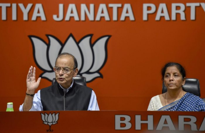 Finance Minister Arun Jaitley addresses a press conference as Defence Minister Nirmala Sitharaman looks on, at BJP headquarters in New Delhi, on Friday. PTI