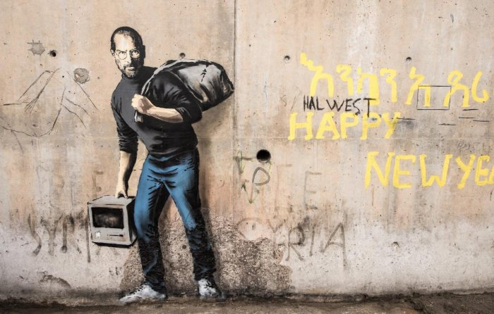 One of Banksy's iconic murals, Son of a Migrant from Syria, which shows Steve Jobs as a Syrian refugee. Artists like Banksy have helped bring social injustices across the world to the fore.