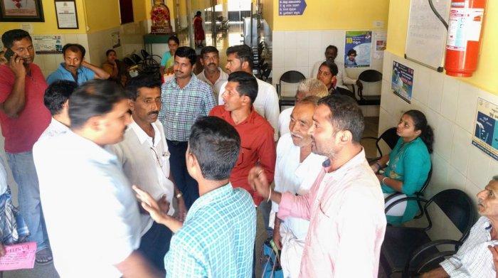 People wait for their turn to register their names under Ayushman Bharat Arogya Karnataka scheme at the Community Health Centre in Kalasa.