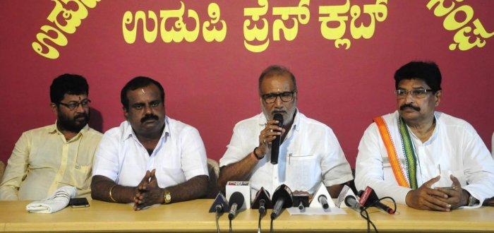 Minister for Animal Husbandry and Fisheries Venkata Rao Nadagowda speaks to media in Udupi on Wednesday.