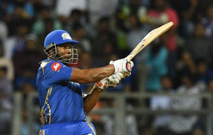 Mumbai Indians' Kieron Pollard sends one soaring over the fence against Kings XI Punjab in Mumbai on Wednesday. AFP