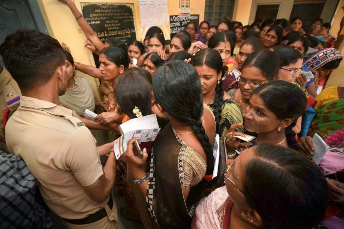 Women wait to cast their votes for Lok Sabha and Assembly elections at a polling station in Rangareddy district, Thursday, April 11, 2019. (PTI Photo)