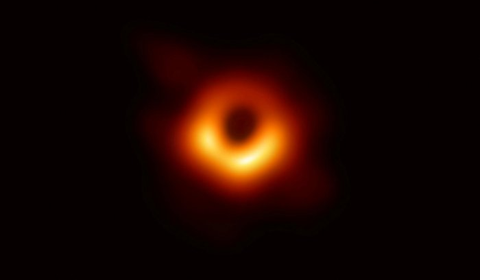 The first ever photo of a black hole, taken using a global network of telescopes, conducted by the Event Horizon Telescope (EHT) project, to gain insight into celestial objects with gravitational fields so strong that no matter or light can escape, is sho
