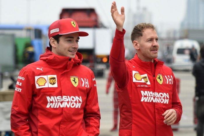 Ferrari's Sebastian Vettel (right) and Charles Leclerc . AFP