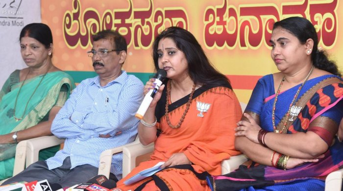 BJP state committee spokesperson Malavika Avinash speaks at a press conference at BJP election office in Mangaluru on Thursday.