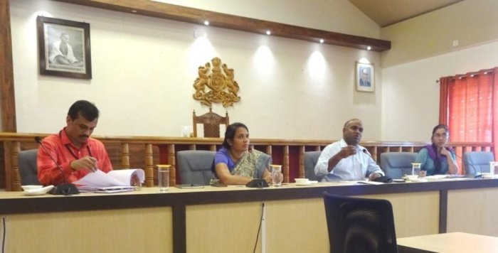 District In-charge Secretary V Anbu Kumar chairs a progress review meet at the DC's office on Thursday.