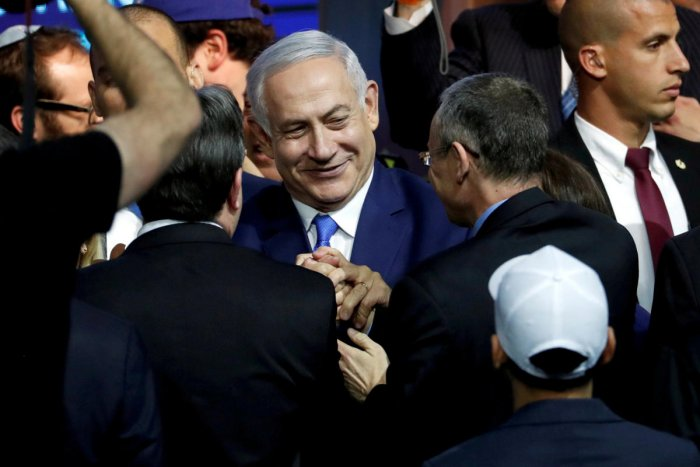 Israeli Prime Minister Benjamin Netanyahu is greeted by supporters of his Likud party as he arrives to speak following the announcement of exit polls in Israel's parliamentary election in Tel Aviv, Israel on April 10, 2019. REUTERS